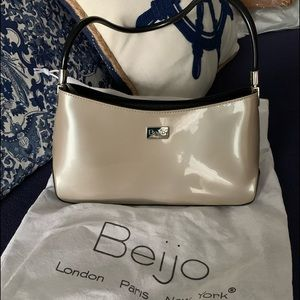 Beau small shoulder bag price is firm